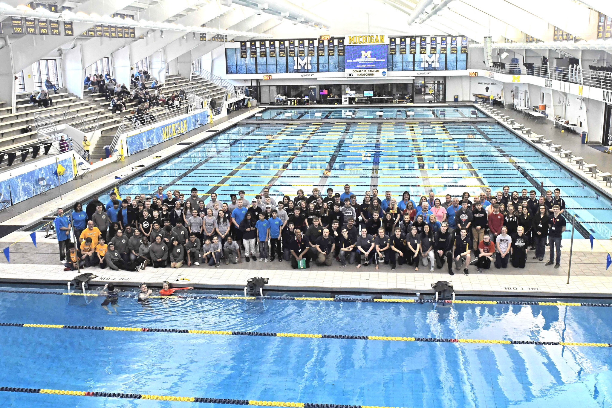 SeaPerch Robotics Challenge participants standing for photo beside University of Michigan Pool