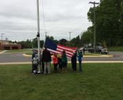 Students and staff unveiling the new flag and flag pole